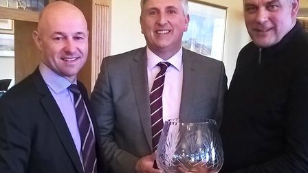 Paul Searle, managing director of Searles Leisure Resort, hands over the trophy to amateur Grant Beg