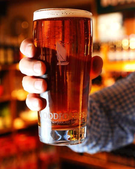 drink beer Woodforde's Brewery in the broadland village of Woodbastwick.A pint of Flagon Dry.March 2