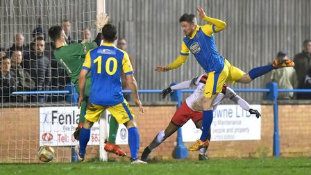 King's Lynn Town's Michael Gash scores against Kettering - the two teams are battling for second pla