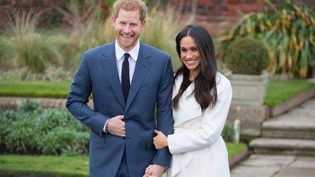 Prince Harry and Meghan Markle pose for photographs in the Sunken Garden at Kensington Palace in Lo