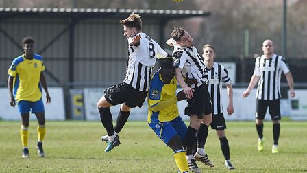 Dereham Town's Jamie Forshaw and (8) Sam Borrer challenge for the ball. Picture: Ian Burt