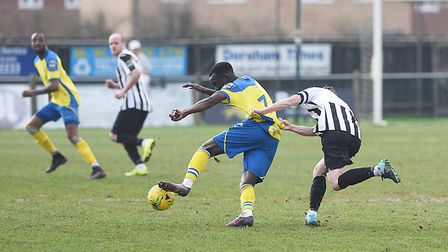Dereham Town's captain David Hinton was booked for pulling down his opponent midway through the firs