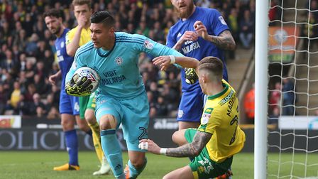 Cardiff keeper Neil Etheridge pushes James Maddison back to the floor after saving at the City midfi
