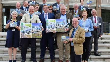 A47 Alliance Chairman Martin Wilby (front) with members of the alliance on the steps of County Hall