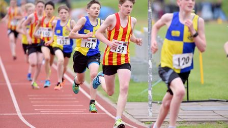 Action from the boys' under 15 1500m race at the Athletics Norfolk Track & Field Championships. Pict