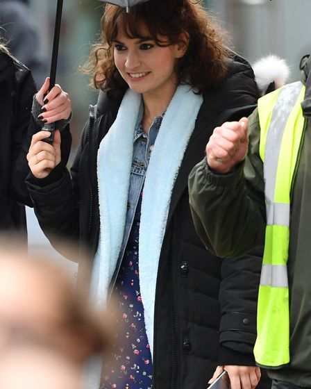 Lily James during the shooting of a scene for Danny Boyle's new film, in the Halesworth. Picture Joe