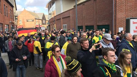 Norwich City fans taking part in a friendly pre-derby match march in February. Picture: SOPHIE WYLLI