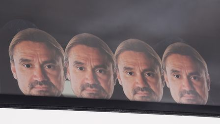 Daniel Farke masks on one of the Norwich City fans' coaches bound for the Emirates Stadium and the A