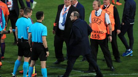 Republic of Ireland's senior team manager Martin O'Neill confronts referee Zbynek Proske after the p