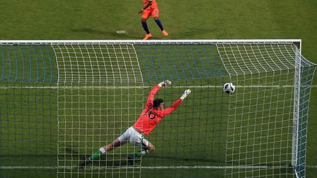 Daishawn Redan scores the winning goal during the penalty shoot out. Picture: Mike Egerton/PA Wire.