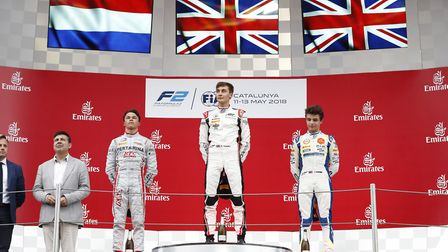 George Russell on the top step of the feature FIA Formula Two Championship podium with second-placed