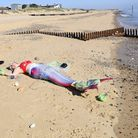 Norfolk mermaid Hannah Pearl takes part in a photo shoot at Caister to highlight damage caused by pl