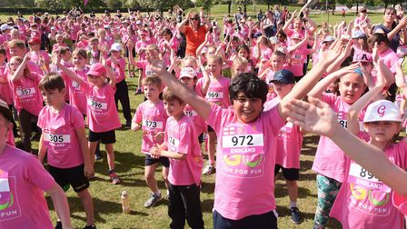 Schoolchildren enjoying the warm-up before taking part in the Go Run for Fun event at Eaton Park. Pi