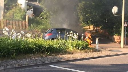 The car on fire on Thorpe Rd in Norwich (Picture: Paddy Davitt)