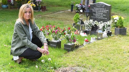 Tracey Bullen by her fathers grave inside Thorpe St Andrew graveyard. She is unhappy with the condit