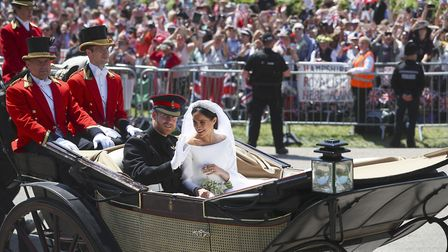 Prince Harry and Meghan Markle ride in an Ascot Landau after their wedding ceremony at St. George's