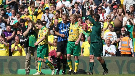 From left, Paul McVeigh, Jurgen Klinsmann, Gary Holt and Andy Marshall in action at Carrow Road.