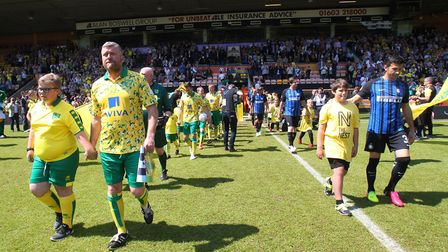 The players take to the pitch with Inter being led out by Javier Zanetti and Norwich by Rob Newman.