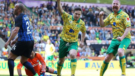 Paul McVeigh celebrates pulling back a goal for Norwich City Legends against Inter Forever, with Iwa