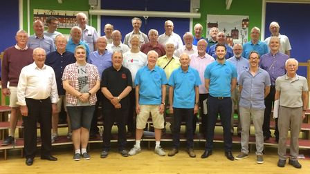Former chairmen of the Norwich Barbershop Singers Chris Durdin and Jeff Jordan (4th and 5th from lef