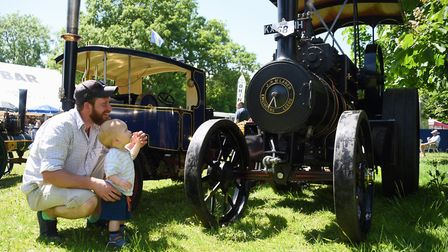 Stanley Stone, 13-months-old, studies a steam scale model with his dad, Matthew, at the Strumpshaw S