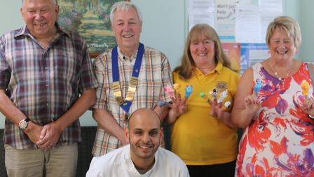 West Earlham Dental Health Practice Owner, Gautam Sharma with members of the Taverham and District L