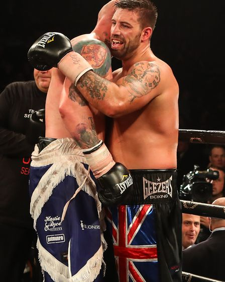 Sam Sexton and Gary Cornish embrace after the Norwich man won the British title in Edinburgh. Pictur