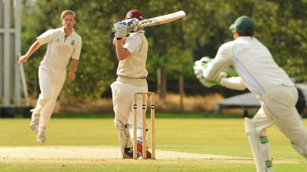 Norwich wicketkeeper Jason Blake moves to catch the ball bowled by Dominic Mirner from Swardeston pl