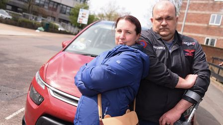 Sarah and Jamie Clare at the site of the sinkhole which damaged their car on Rouen Road in Norwich i