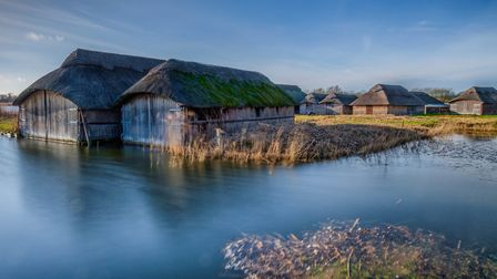 Thatched boathouses at Hickling Broad on a lovely sunny afternoon.