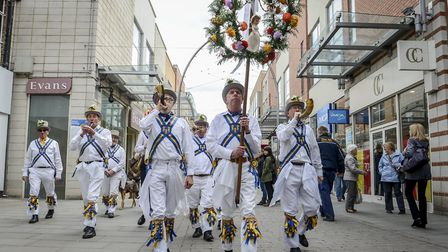 The King's Morris take the May Day garland blowing their ox horns, around the town centre in King's