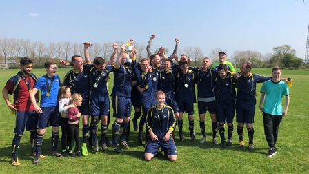 Norman Wanderers A celebrate the Division Three title. Picture: Gabby Evbota