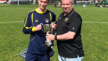 Norman Wanderers A captain Alain Elsley-Medina receives the Division Three trophy. Picture: Gabby Ev