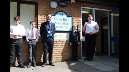 Eaton Hall headteacher Keith Bates wtih students celebrating the school's outstanding Ofsted Report.