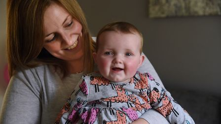 Claire Wright, with her daughter, eight-months-old Esme Ives, who has cystic fibrosis, at their home