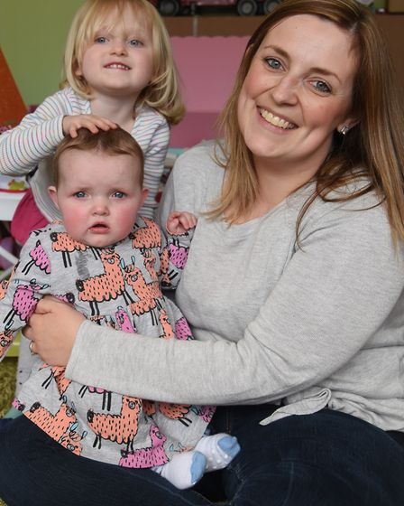 Claire Wright, with her daughters, eight-months-old Esme Ives, who has cystic fibrosis, and two-year