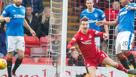 Kenny McLean converted a penalty after being felled. Picture: Jeff Holmes/PA Wire.