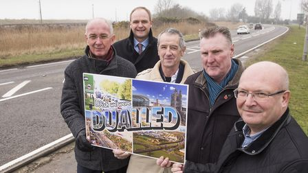 Great Yarmouth business bosses and councillors with a Campaign poster to get the A47 dualled along t