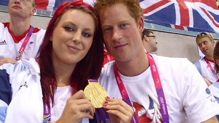 Norfolk swimming star Jessica-Jane Applegate celebrates her London 2012 Paralympic success with Prin