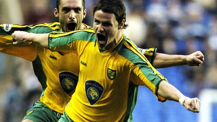 Phil Mulryne celebrates scoring during a vital win at Reading in April 2004, as Norwich City closed