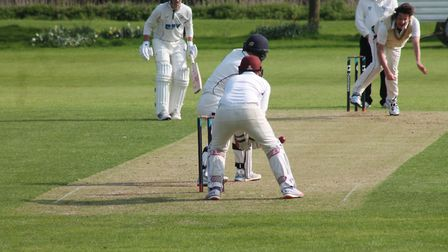 Mark Thomas bowling during Swardeston's opening day defeat at Mildenhall. Picture: Kevin Denmark