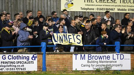 Lynn fans celebrate at the final whistle. Picture: Ian Burt