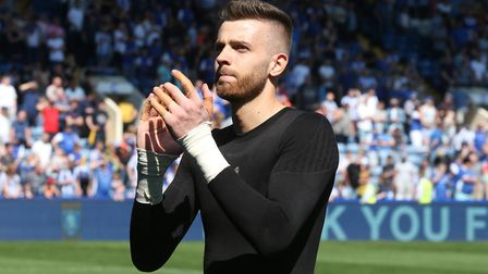 Angus Gunn of Norwich says his goodbyes to the traveling Norwich fans at the end of the Sky Bet Cham