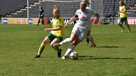 Norwich City Ladies' Brydie Siryj tracks Louise Naylor, the Dons captain. Picture: Brian Coombes