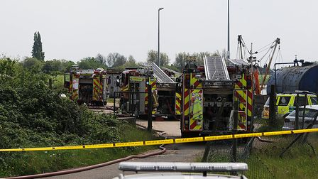 Firefighters have been tackling a fire on board a derelict barge in King's Lynn. Picture: Chris Bish