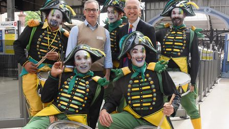 The Transe Express drummers with Norfolk and Norwich Festival director, Daniel Brine, back second le