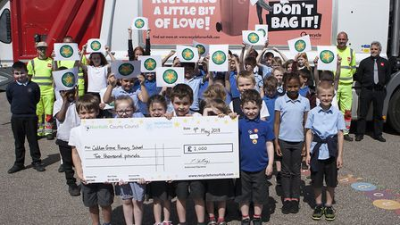 Pupils at Catton Grove Primary School celebrate earning 2000 from taking part in the 'Recycling Star