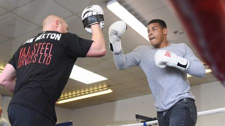 Norwich City footballer Onel Hernandez spars during boxing training as he supports Sam Sexton's bid