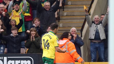 Wes Hoolahan celebrates his equaliser against Leeds with the Carrow Road faithful. Picture by Paul C