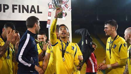 Man of the match Nathan Stewart enjoys Senior Cup final success with Norwich United. Picture: Ian Bu